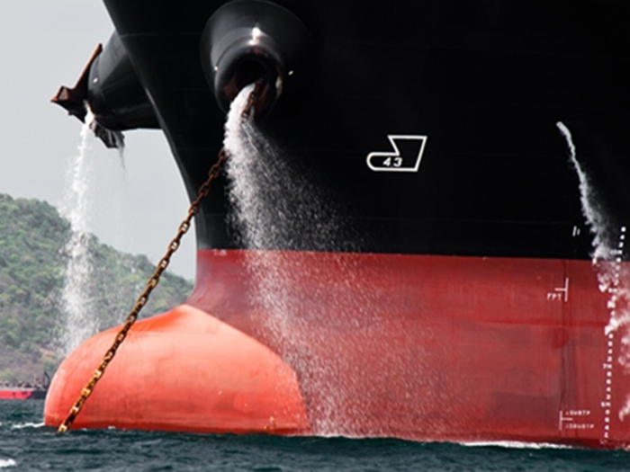 Image of ballast water being discharged from ship's bow