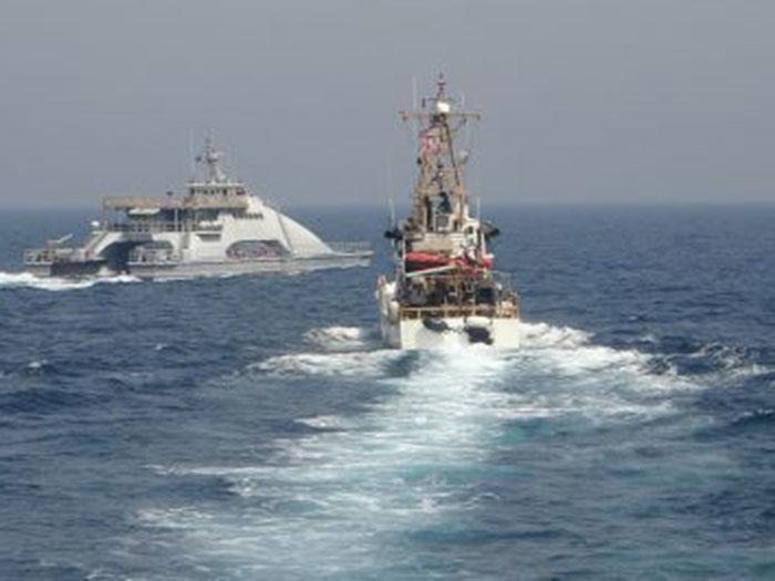 Iranian ship cuts across bow of USCG cutter
