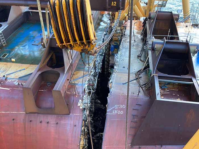 Deep groove between sections of wreck