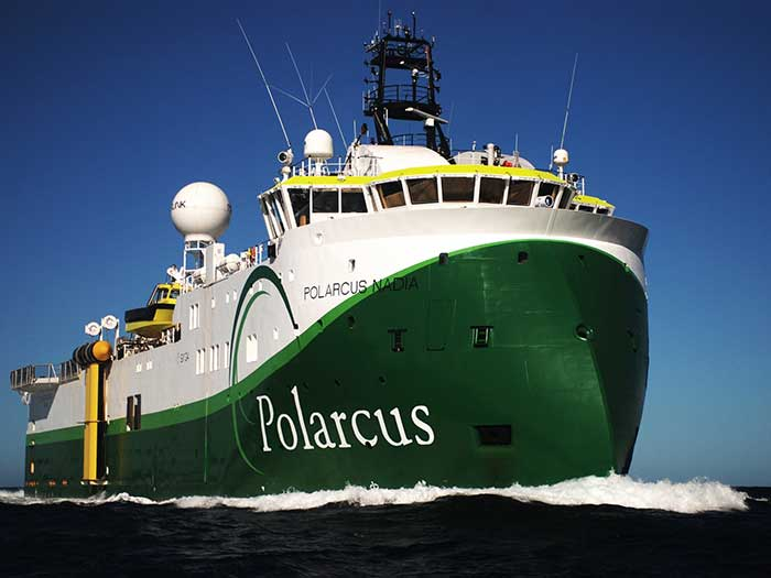 Green ship with Polarcus on bow
