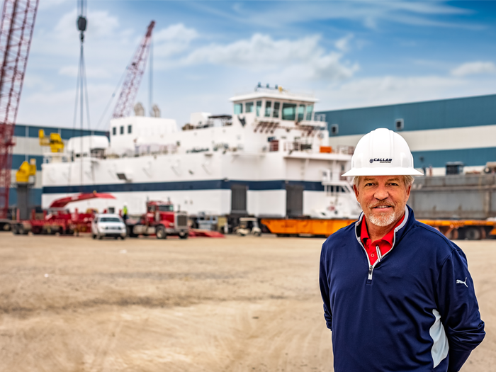 Maxie McGuire of Callan Marine with the General MacArthur dredge behind him