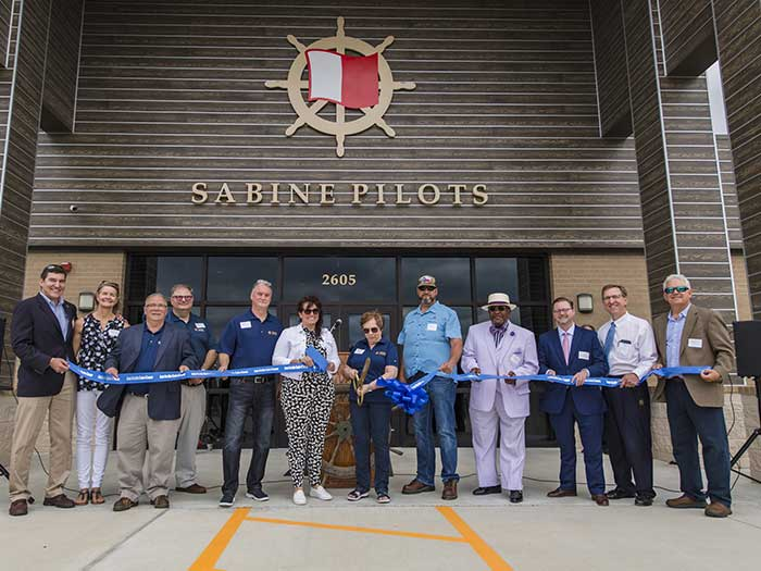 Group assembled for ribbon cutting of new pilot headquRTERS