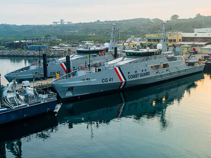 Two patrol boats alongside at shipyard