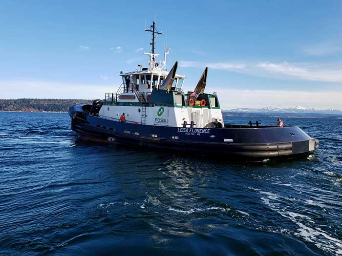 Tugboat seen from three-quarters astern