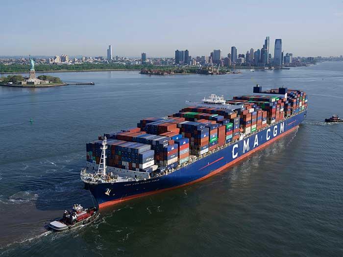 CMA CGM Marco Polo with tugboats