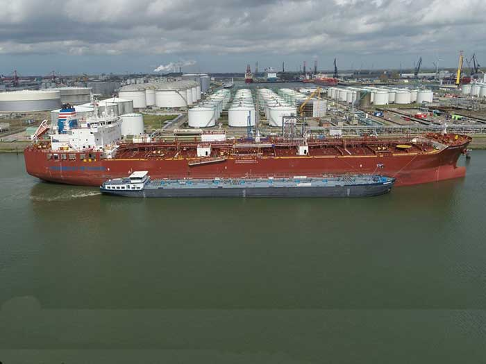 Barge in front of methanol carrier