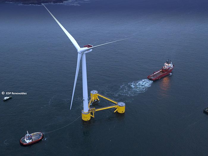Boat approaching floating wind turbine