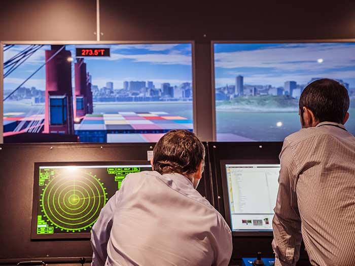 Two men on simulator bridgde
