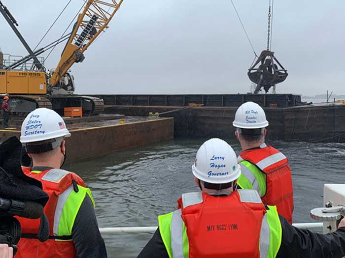 Officials observe dredging activity