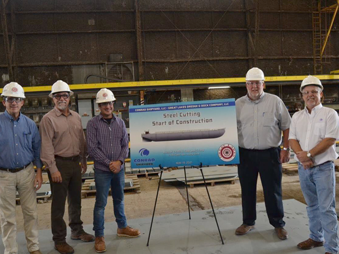 Attendees at dump scow barge steel cutting
