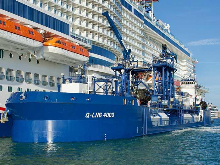 Bunkering barge alongside cruise ship