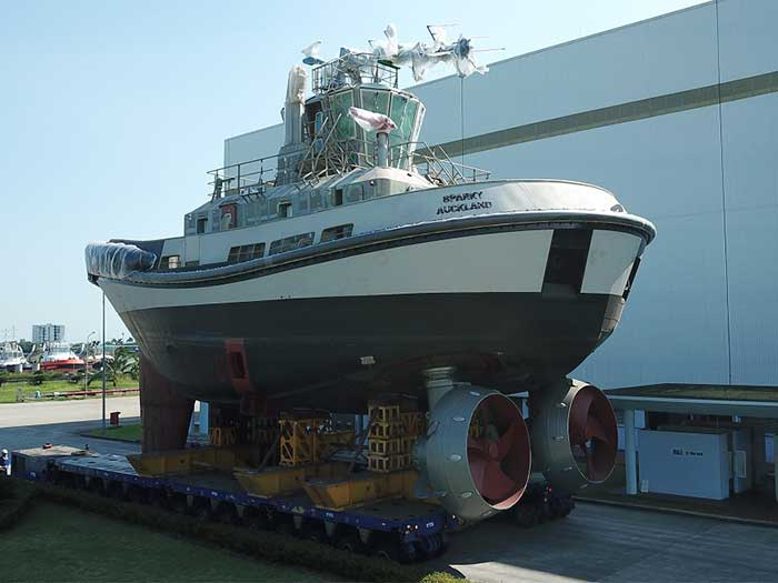All electric tug oustide paint shop