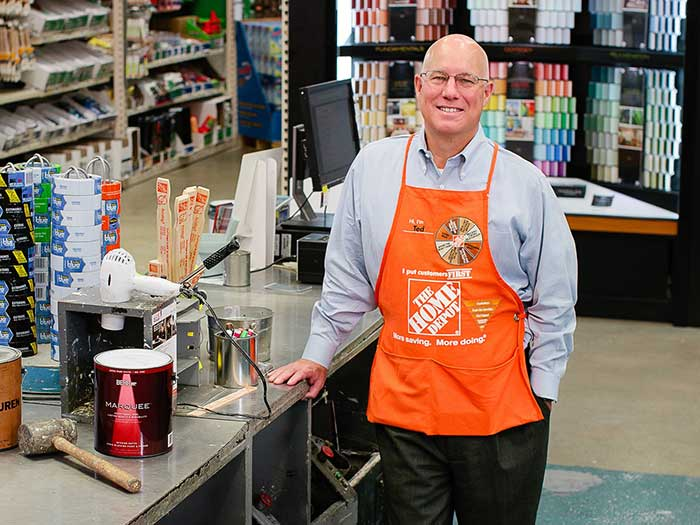 Home Depot's Ted Decker in orange apron