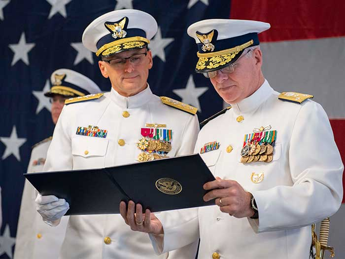 Rear Adm. John P. Nadeau (left) transferred command of the Coast Guard 8th District to Rear Adm. Richard V. Timme.