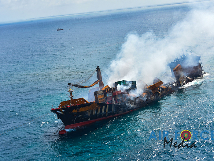 Burned out shell of containership seen from air