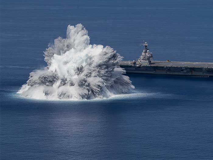 Huge explosion off aircraft carrier bow