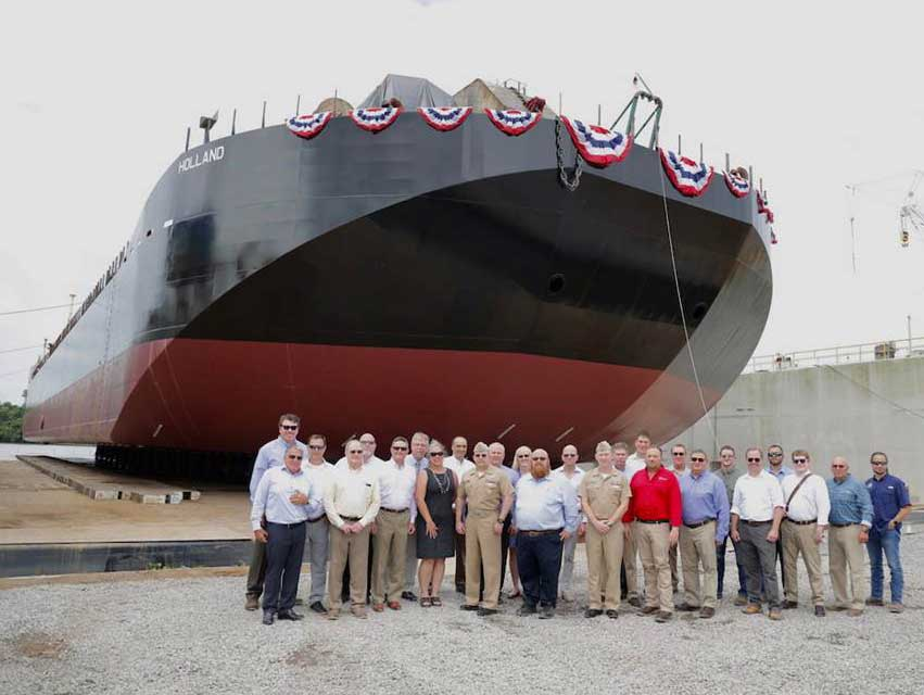 Group in front of ocean transport barge