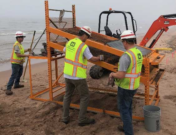U.S Army Corps of Engineers, Duluth Area Office Floating Plant crew designed and fabricated a screening machine to filter the debris from the beach on Minnesota Point.