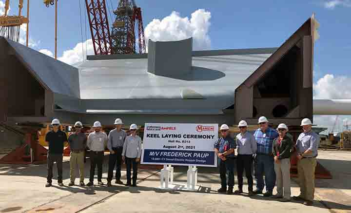 Group of executives at keel layingv ceremony for new dredge