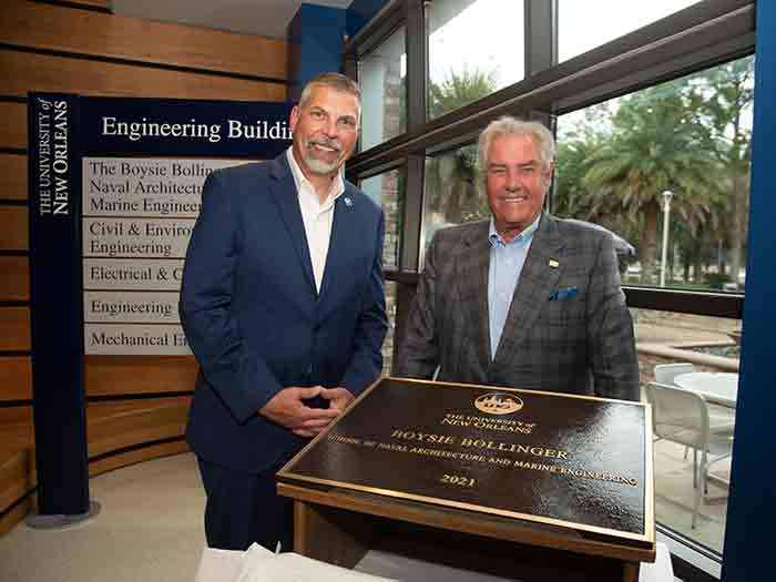 """Donald T. """"Boysie"""" Bollinger (R) and UNO President John Nicklow with plaque bearing new name of university's School of Naval Architecture & Marine .Engineering,"""