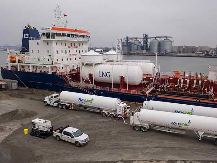 Vessel being bunkered with LNG by tanker trucks