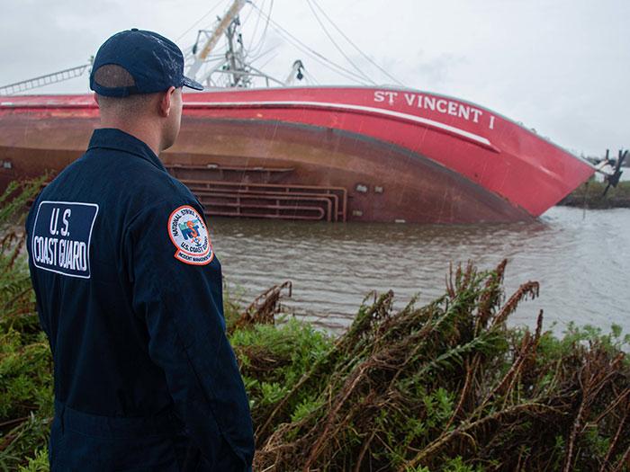 Coast Guard member eyes part capsized vessel