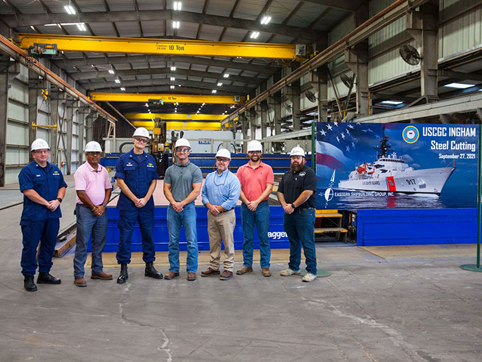 USCG and ESG personnel at steel cutting ceremony