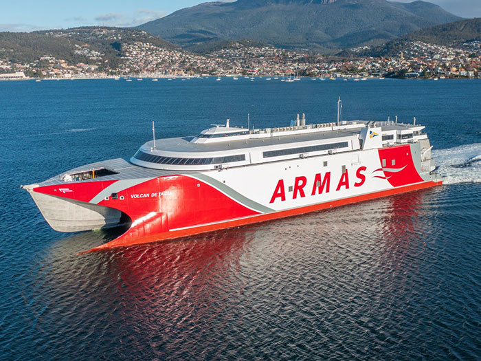 Red and white high speed catamaran ferry.