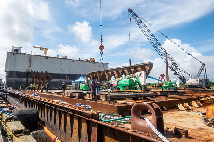 Modifications are made to barge to prepare it to receive section of Golden Ray wreck