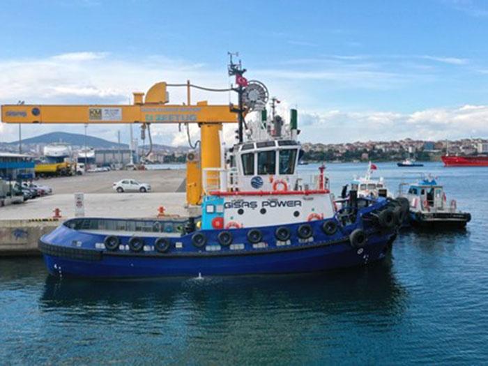 All-electric tugboat alongside in port