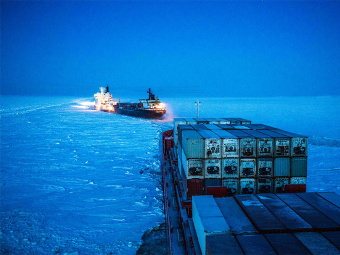 Icebreaker clears path for Nornickel cargo carrier along Norther Sea Route. [Image: Nornickel]