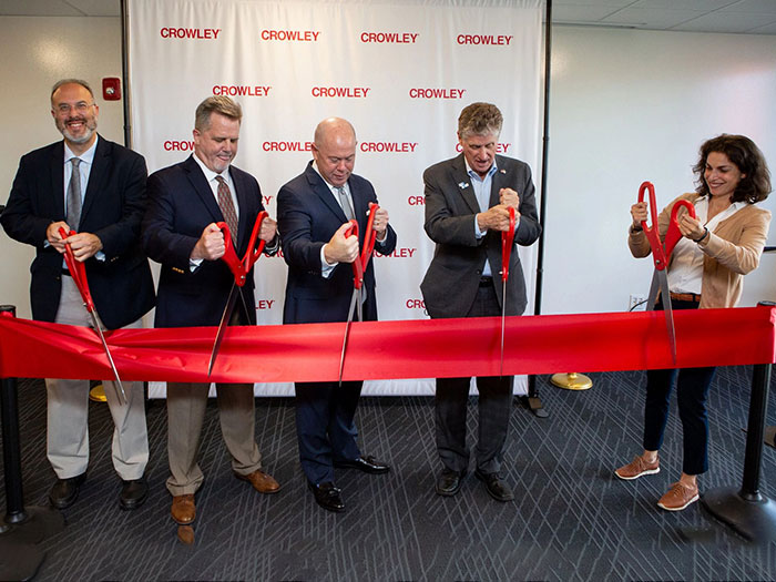 ceremonial ribbon cutting marked opening of ne Crowley office