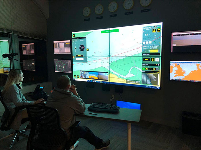 AMO deck officers Bridget Quinn and Adam Szloch remotely command the Nellie Bly in Denmark from Sea Machines' Boston control room. [Image: AMO]