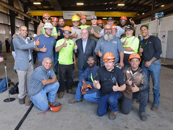 Marcland governor with Crystal steel workers